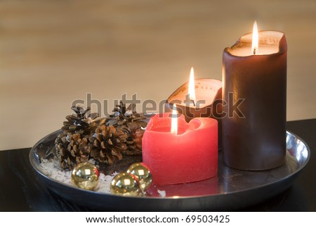 Candles and cones on a silver plate - stock photo