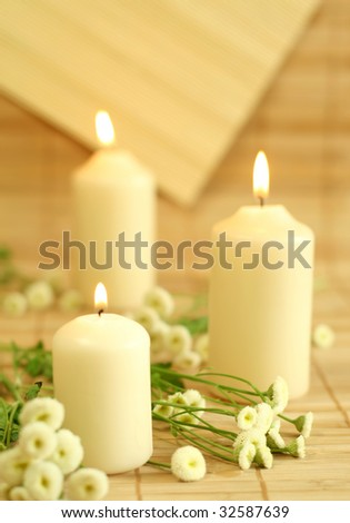 Candles and flowers.