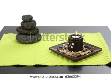 candles and massage stones in a calm zen spas - stock photo