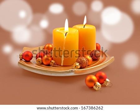 Candles and small christmas tree balls.  - stock photo