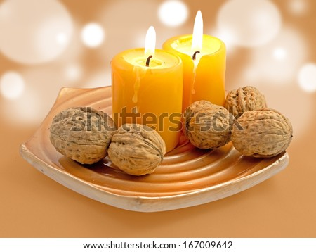 Candles and winter fruits.  - stock photo
