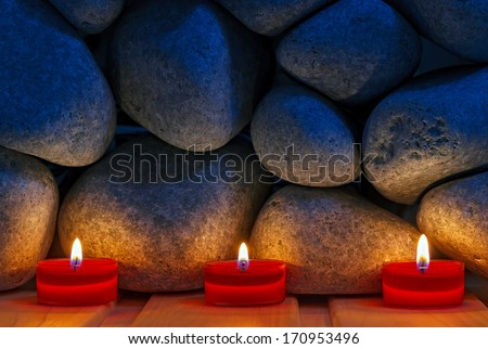 Candles are lit on the background of the sauna stones. Preparing for the ceremony bathhouse - stock photo