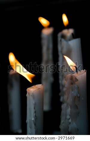 Candles burning in the altar of the church. - stock photo
