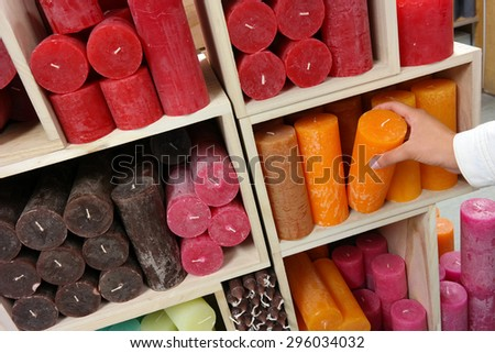 Candles for Sale. Closet full of varied candles in a interior decorating store. - stock photo