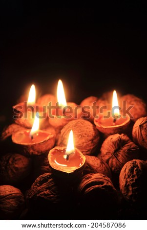 candles from nutshells as nice christmas background