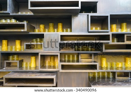 Candles in brown shelf