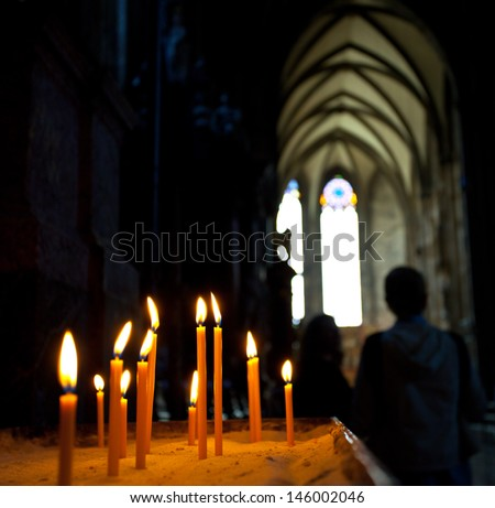 candles in the Catholic Church, shallow depth of field - stock photo