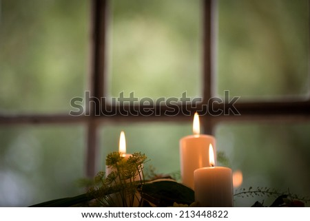 candles in window  - stock photo