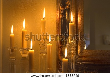Candles light a wall. - stock photo