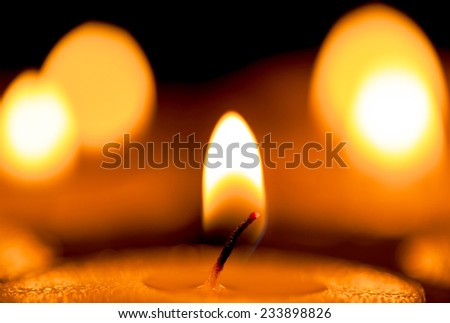 candles light in darkness - stock photo