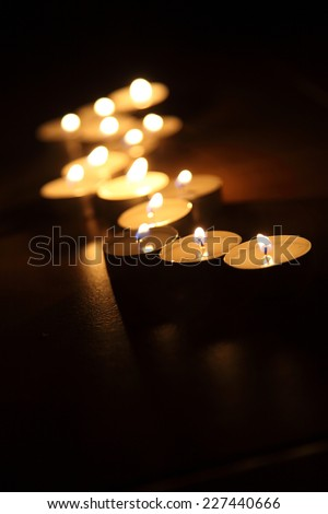 Candles on a dark background - stock photo