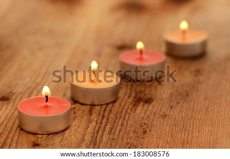 Candles on a wooden board - stock photo