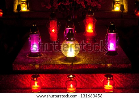 Candles on grave, All Saints Day, Wroclaw, Poland - stock photo