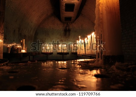 candles with flame inside the church, cathedral marseilles, france - stock photo