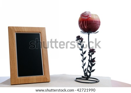 candlestick and photoframe on the table in white background - stock photo