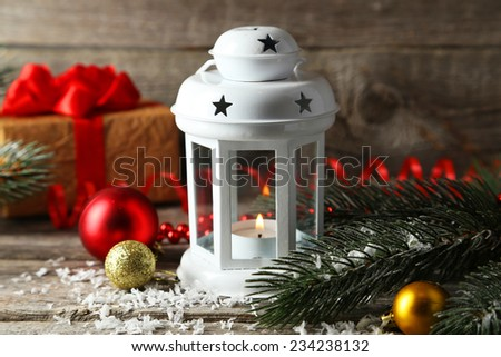 Candlestick with christmas balls on grey wooden background