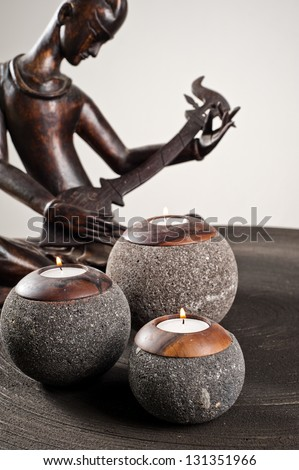 Candlesticks as interior decoration on wooden table - stock photo