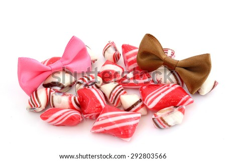 Candy and ribbons of different colors on a white background - stock photo