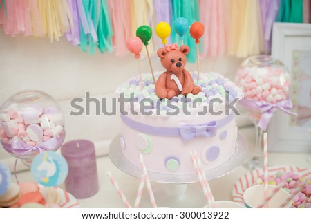 candy bar in pastel colors for children's birthday - stock photo