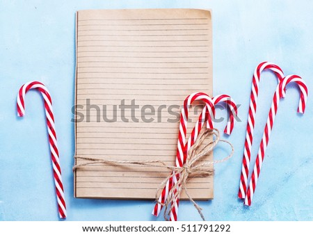 Candy cane on top of paper pad