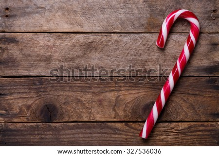 Candy cane on wooden background with copy-space - stock photo