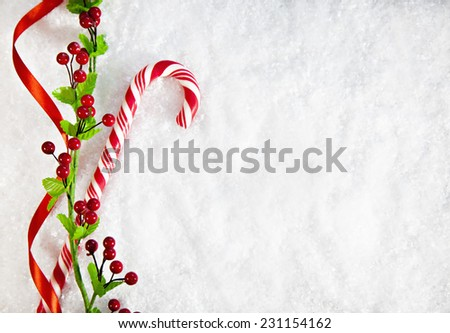 Candy Cane With Christmas Decoration On Snowy Background. Copy Space - stock photo