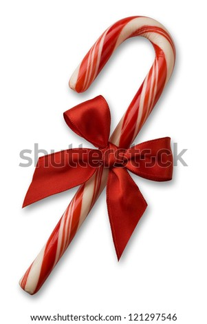 Candy cane with red bow on white background with soft shadow. clipping path included. - stock photo
