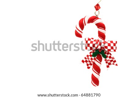 Candy cane with red check ribbon on a white background, Candy cane - stock photo