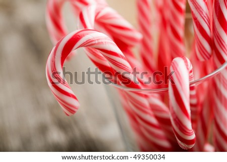 Candy canes with red and white stripes - stock photo
