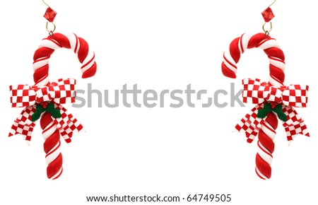 Candy canes with red check ribbon on a white background, Candy cane - stock photo