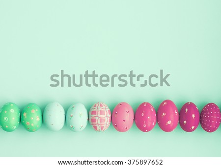Candy color easter eggs over mint  - stock photo