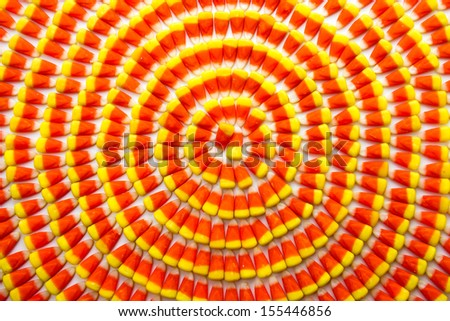 Candy corn background arranged in circles - stock photo
