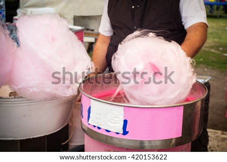 Candy floss machine with pink candyfloss - stock photo