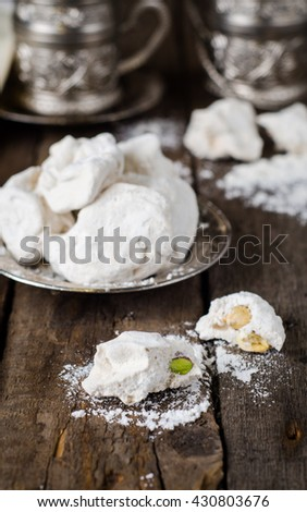 Candy Gaz - arabian delicious nougat with phistachio on vintage plate on wooden background. Selective focus. Eastern food. - stock photo