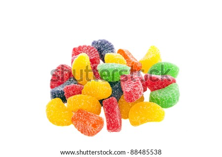 Candy gum drops scattered in a small pile isolated on a white background. - stock photo