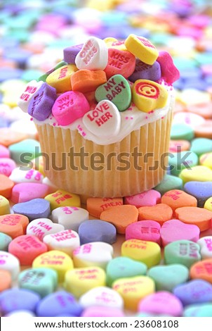 Candy Heart Cupcake surrounded by colorful candy hearts - stock photo