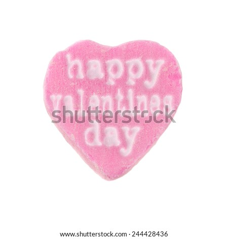 """Candy Heart Happy Valentines Day. Pink candy heart with the words """"Happy Valentines Day"""" printed on it. Valentine's Day concept. - stock photo"""