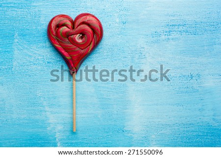 candy heart on a wooden background