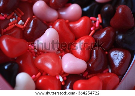 Candy hearts in red, pink and burgundy with sprinkles