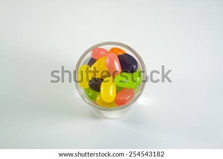 Candy in a glass on a white background.c - stock photo
