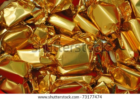 candy in golden wrapper - stock photo