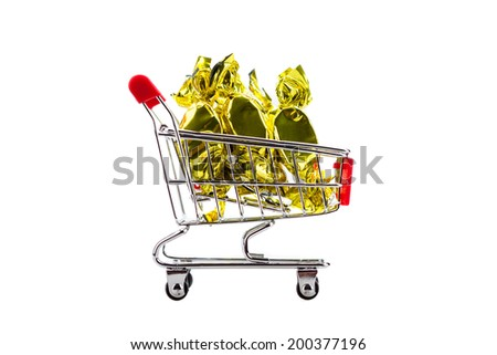 candy in wrappers in shopping cart, isolated on white background - stock photo