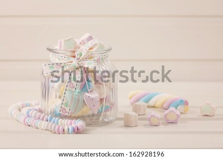 Candy jar filled with colorful marshmallow sweets - stock photo