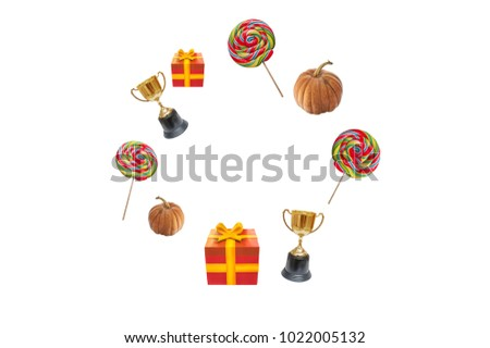 Candy or gift, pumpkin and trophy gold on isolated with circle