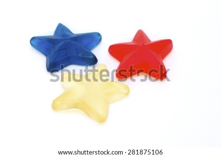 candy stars,jelly, candy, white, isolated, background, sweet, gummy, color, colorful, food, fruit, snack, red, yellow, delicious, dessert, sugar, texture, green, gelatin, holiday, assortment, tasty,  - stock photo