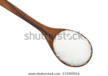 Cane sugar in a wooden spoon. Isolated on white.