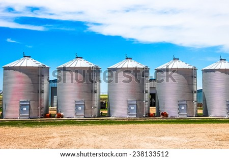 Canisters for the pre-processing of peanuts on a farm. - stock photo
