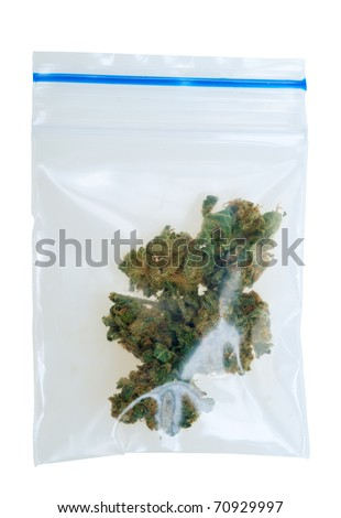 Cannabis in a plastic bag , photo taken with a macro lens, isolated on a white background - stock photo