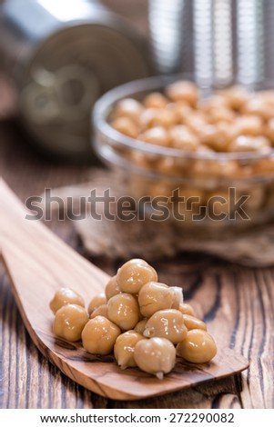 Canned Chick Peas (close-up shot) on vintage wooden background - stock photo