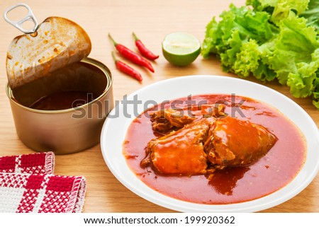 Canned fish in tomato sauce on plate   - stock photo